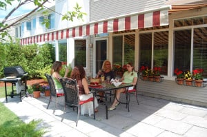 Retractable Patio Awning where you see four ladies sitting at a table enjoying being outside