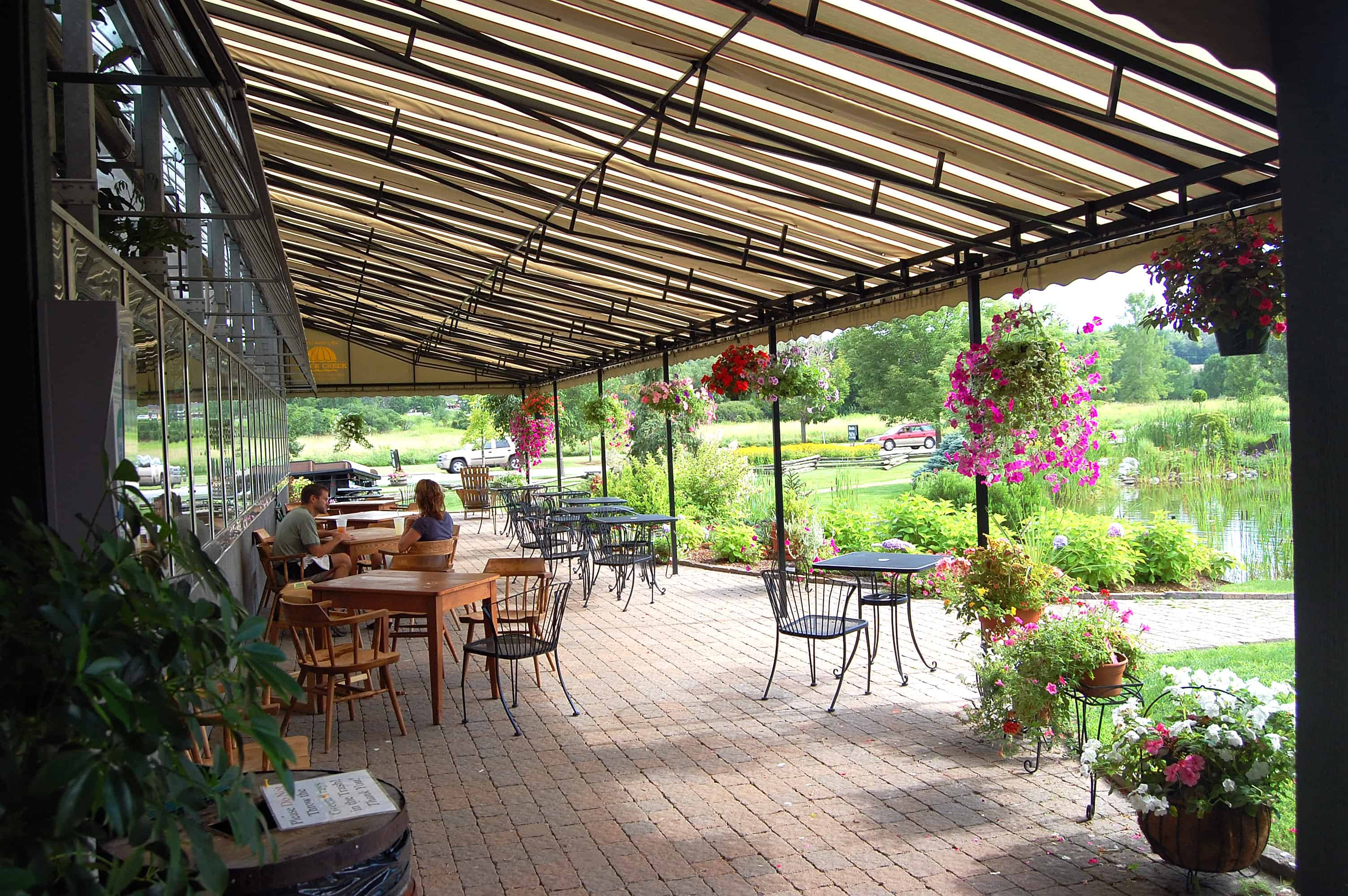 Commercial awnings portfolio otter creek awnings for Garden supply company burlington vt