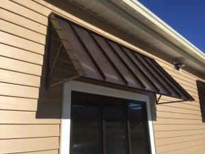 Standing seam metal window awning - Otter Creek Awnings